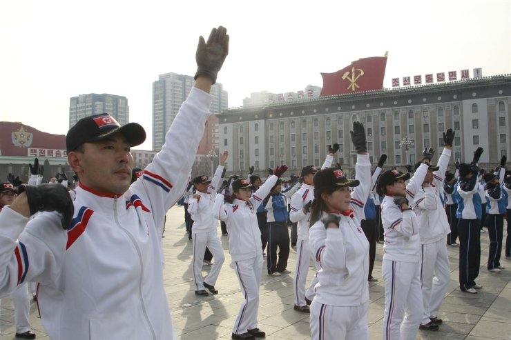 A group of government officials participate in a group exercises on the first official 'sports day' of the new year at the Kim Il Sung Square in Pyongyang, North Korea, Jan. 12, 2020. AP