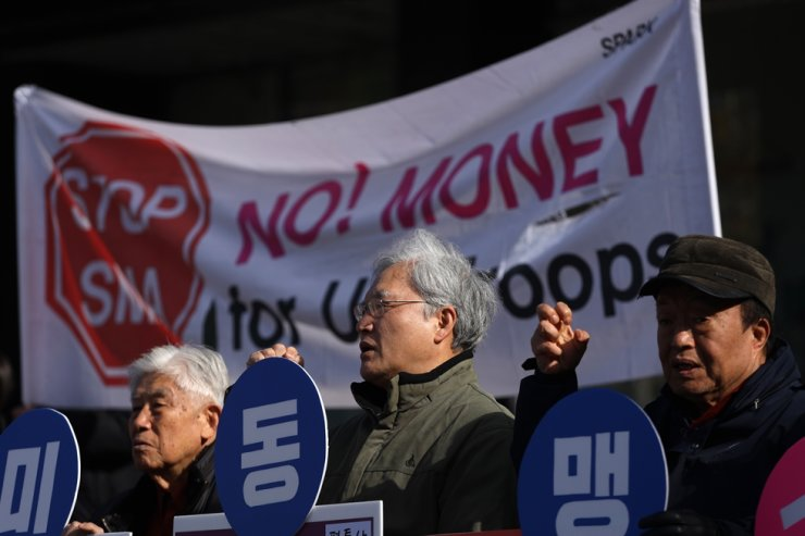 Members of a civic group stage a protest against the 'unfair' defense cost-sharing talks between Seoul and Washington for the upkeep of 28,500 United States Forces Korea troops at Gwanghwamun Square in central Seoul, Nov. 26, 2019. Korea Times file