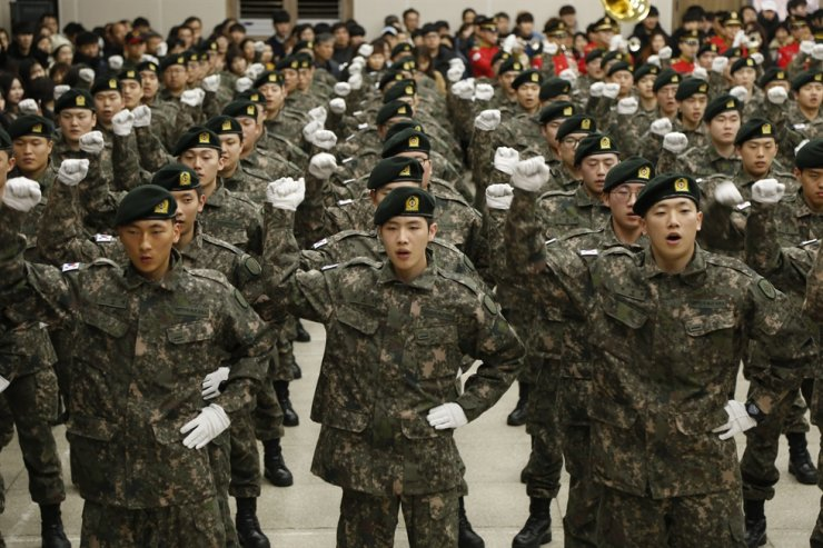 Soldiers sing a military song at a ceremony welcoming new recruits into the armed forces, Jan. 8, Gwangju. / Courtesy of ROK Armed Forces