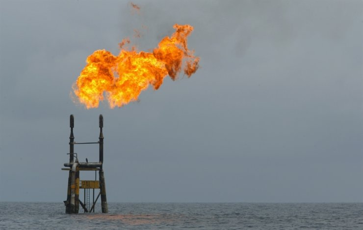In this file photo taken on Oct. 13, 2003, flames rise from a Total Elf Fina offshore oil rig off the Angolan coast. World oil prices jumped on Jan. 3, 2020, after the US killed a top Iranian general, fanning fresh fears of conflict in the crude-rich Middle East, with Tehran warning of 'severe' retaliation. AFP
