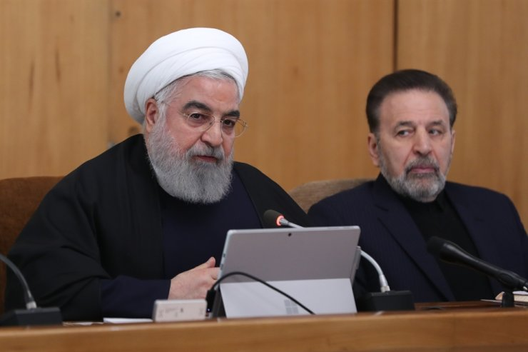 A handout picture provided by the Iranian presidency shows the Islamic republic's President Hassan Rouhani (L) chairing a cabinet meeting in Tehran on January 8, 2020. AFP