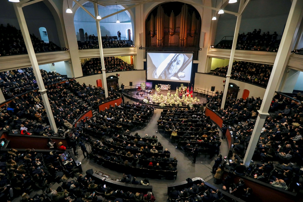 Mourners attend a memorial for the victims of a Ukrainian passenger plane which was shot down in Iran, at Convocation Hall in Toronto, Ontario, Canada, Jan. 12, 2020. Reuters