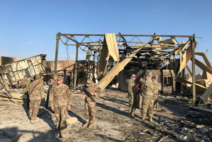 U.S. soldiers inspect the site where an Iranian missile hit at Ain al-Asad air base in Anbar province, Iraq Jan. 13, 2020. Reuters