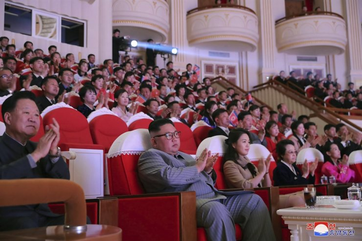 In this Saturday, Jan. 25, 2020, photo provided by the North Korean government, North Korean leader Kim Jong-un, center, claps with his wife Ri Sol-ju, third from right, and his aunt Kim Kyong-hui, second from right, as they attend a concert celebrating Lunar New Year's Day in Pyongyang, North Korea. AP