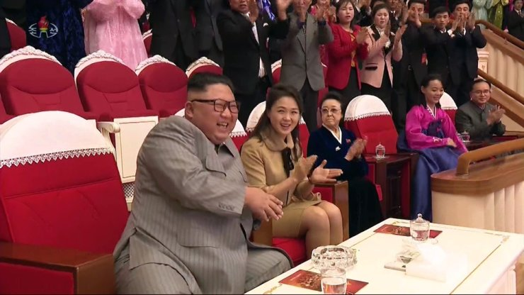 North Korean leader Kim Jong-un attends a Lunar New Year performance with family members and high-ranking officials at the Samjiyon Theater in Pyongyang, Saturday, in this footage aired by the state-run Korean Central Television the following day. From left are Kim, his wife Ri Sol-ju, aunt Kim Kyong-hui, sister Kim Yo-jong and Jo Yong-won, a close aide to the leader. Yonhap