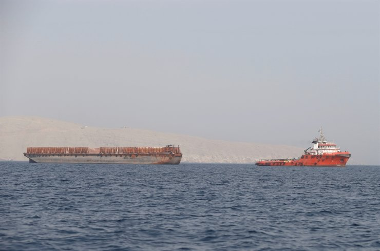 A tugboat moves cargo towards the Strait of Hormuz off the coast of Musandam province, Oman, July 20, 2018. Reuters