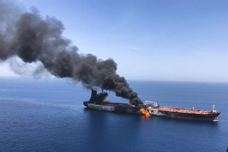 An oil tanker is on fire in the Sea of Oman near the Strait of Hormuz in this June 2019 file photo. / AP-Yonhap