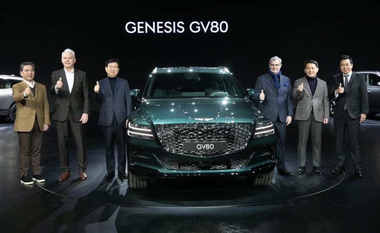 Hyundai Motor CEO Lee Won-hee, third from left, and Genesis Global Head Lee Yong-woo, second from right, pose with the Genesis GV80 during its launch event in Goyang, Gyeonggi Province, Wednesday. Yonhap
