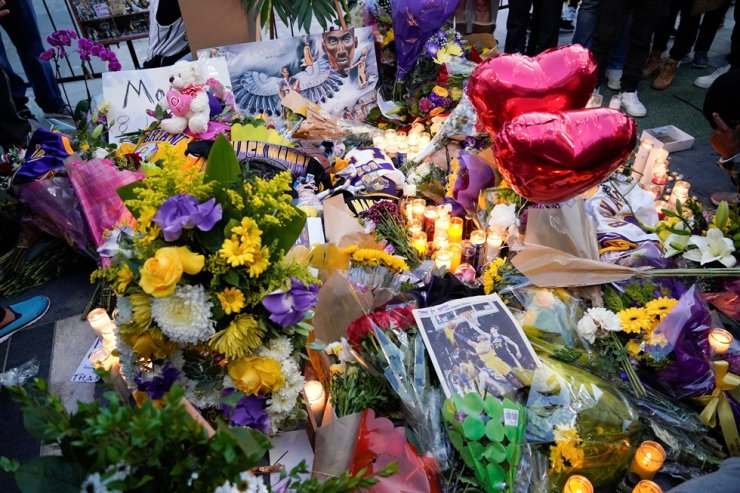Flowers and memorabilia left as a tribute near the Staples Center to pay respects to Kobe Bryant after a helicopter crash killed the retired basketball star, in Los Angeles, Calif., U.S., Jan. 26, 2020. Reuters