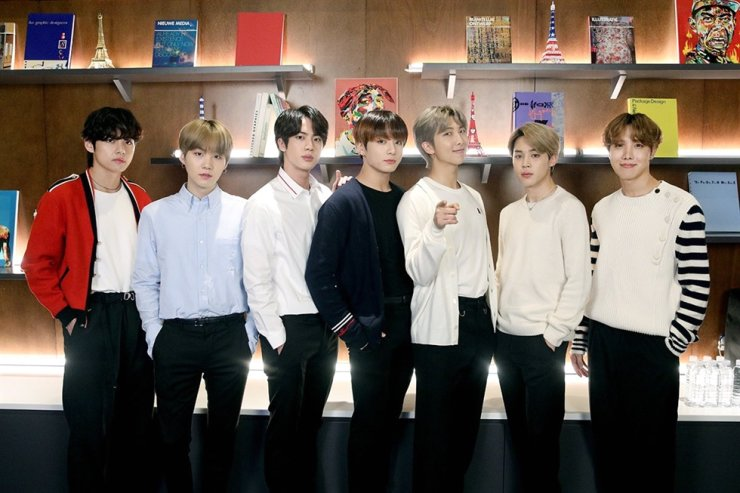 BTS members pose for a group photo after announcing their global art project 'Connect, BTS,' Jan. 14. / Courtesy of Big Hit Entertainment