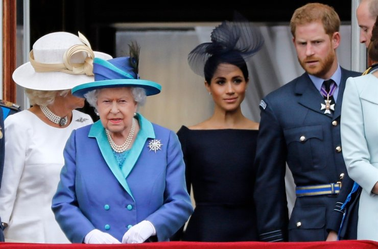 In this file photo taken on July 10, 2018 (L-R) Britain's Camilla, Duchess of Cornwall, Britain's Queen Elizabeth II, Britain's Meghan, Duchess of Sussex, Britain's Prince Harry, Duke of Sussex, AND Britain's Prince William, Duke of Cambridge come onto the balcony of Buckingham Palace to watch a military fly-past to mark the centenary of the Royal Air Force (RAF).