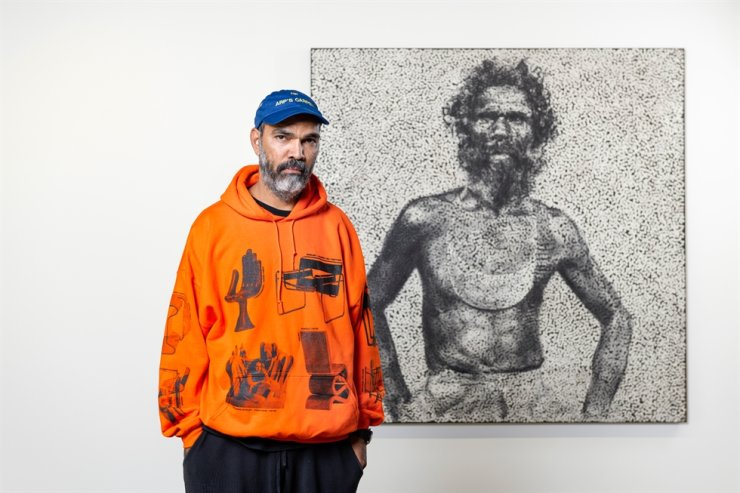 Australian artist Daniel Boyd poses in front of 'Untitled (YMKSMRWAKP)' at Kukje Gallery Busan in southern city of Busan in December. Courtesy of Kukje Gallery