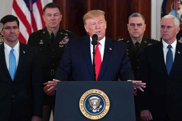 US President Donald Trump(center) speaks about the situation with Iran in the Grand Foyer of the White House in Washington, DC, January 8, 2020. /AFP