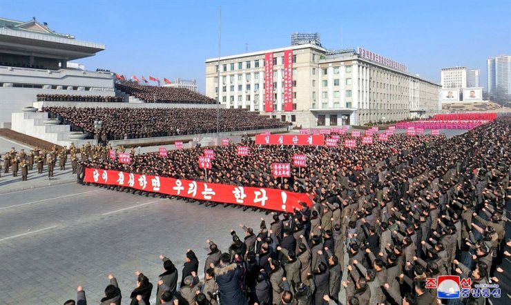 North Koreans march at Kim Il-sung Square in Pyongyang, Sunday, in this photo released by North Korea's state-run Korean Central News Agency. / Yonhap