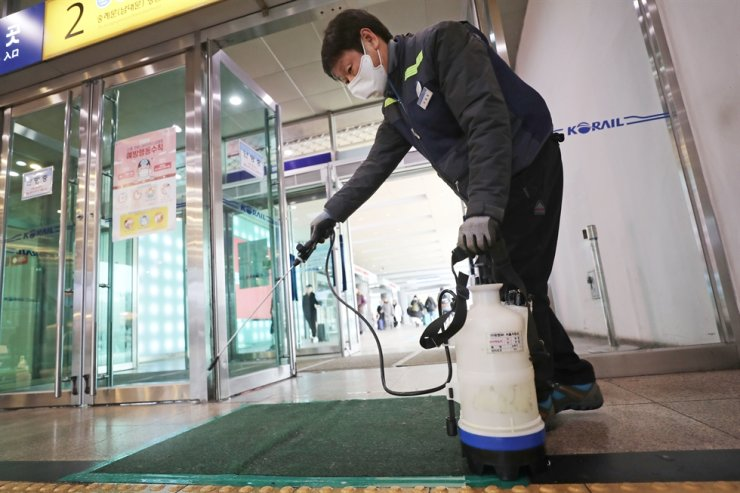 A KORAIL official sprays disinfectant at Seoul Station, Monday, as part of the nation's ongoing efforts to prevent the spread of the Wuhan coronavirus here. / Yonhap