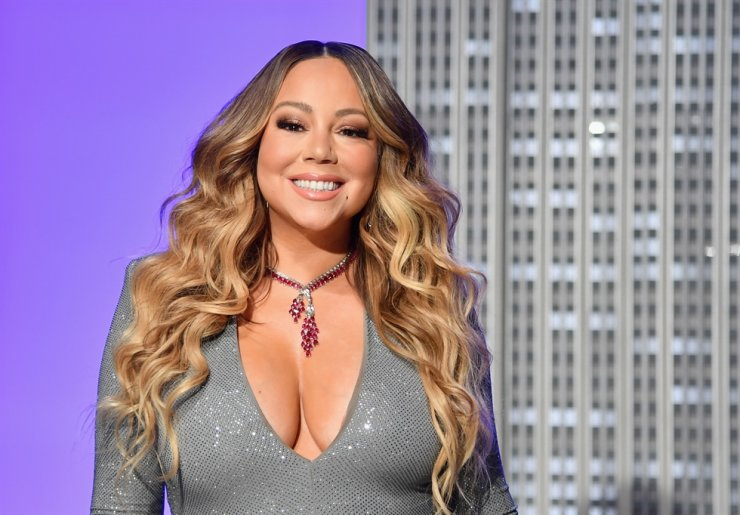 In this file photo taken on December 17, 2019 US singer Mariah Carey participates in the ceremonial lighting of the Empire State Building in celebration of the 25th anniversary of 'All I Want For Christmas Is You.' /AFP