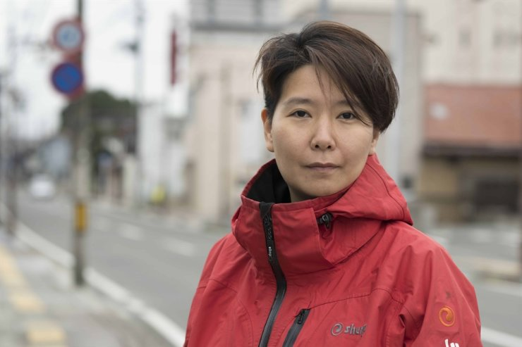 Chang Mari, a Climate and Energy Campaigner at the Greenpeace East Asia Seoul Office, poses for a picture during the inspection in Fukushima, Japan, in October 2019. / Courtesy of Greenpeace Korea