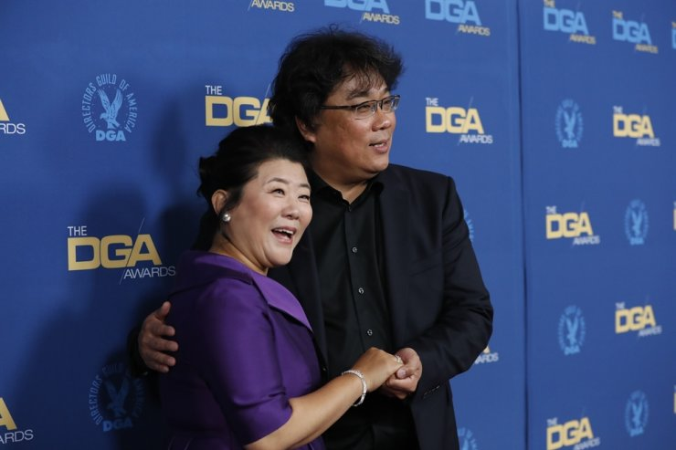 Lee Jung-eun, left, and Bong Joon-ho, director of 'Parasite' and nominee for Outstanding Directorial Achievement in Theatrical Feature Film category, attend the 72nd Annual DGA Awards in Los Angeles, California, U.S., Jan. 25, 2020. Reuters
