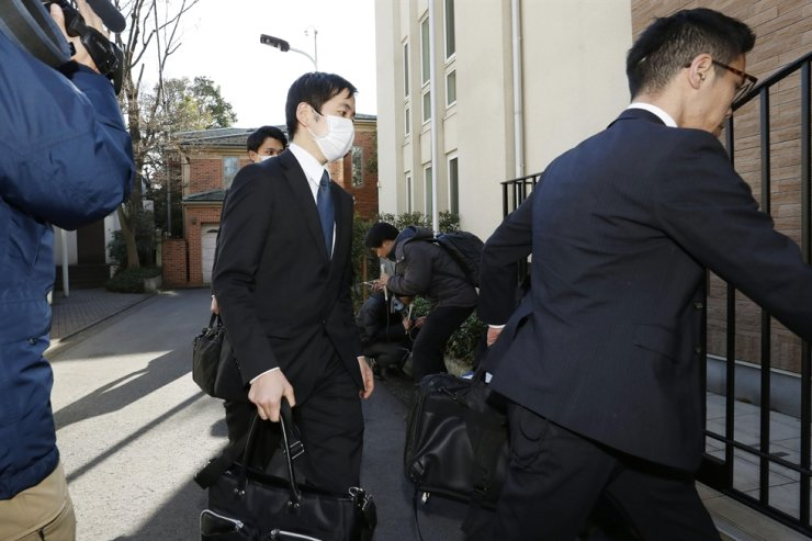 Prosecutors arrives at former Nissan Chairman Carlos Ghosn's residence for a raid in Tokyo Thursday, Jan. 2, 2020. AP