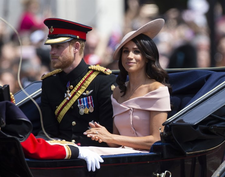 Britiain's Prince Harry, left, the Duke of Sussex, and Meghan, the Duchess of Sussex sit in a carriage during the Trooping of the Colour, Queen's 92th birthday parade outside Buckingham Palace in London, Britain, June 9. Harry and his wife Meghan have announced in a statement on Jan. 8 that they will step back as 'senior' royal family members and work to become financially independent. EPA