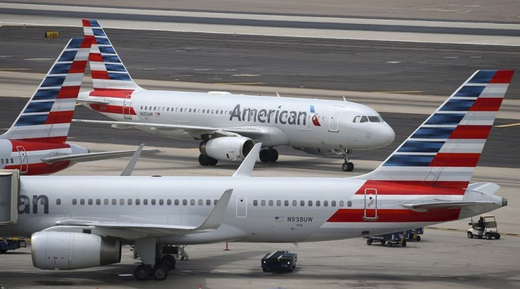 This July 17, 2019, file photo shows American Airlines planes at Phoenix Sky Harbor International Airport in Phoenix. The pilots' union at American Airlines filed a lawsuit on Jan. 30, 2020, to block the carrier from flying to China and told members not to operate flights there because of the spreading coronavirus outbreak. AP