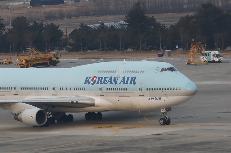 A Korean chartered plane carrying evacuees from Wuhan, China, taxis after landing at Gimpo International Airport in Seoul, Friday, Jan. 31, 2020. AP