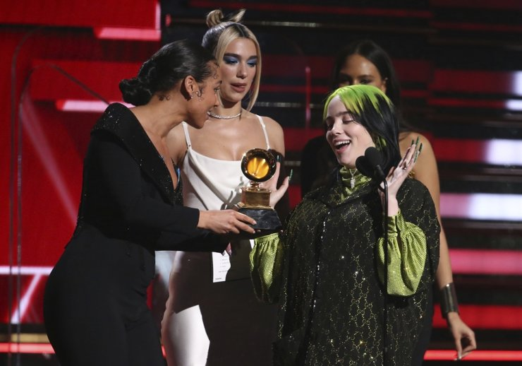 Alicia Keys, from left, and Dua Lipa present Billie Eilish with the award for best new artist at the 62nd annual Grammy Awards on Sunday, Jan. 26, 2020, in Los Angeles. AP