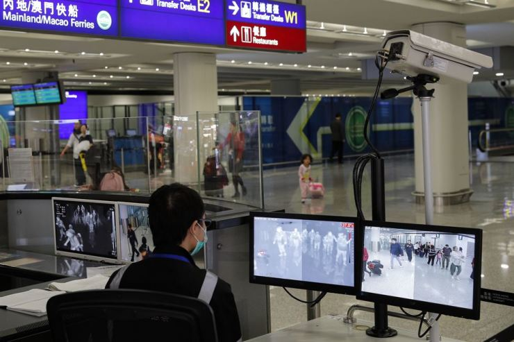 In this Jan. 4, 2020, file photo, a health surveillance officer monitors passengers arriving at the Hong Kong International airport in Hong Kong. AP-Yonhap