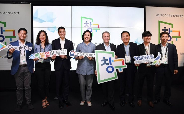 Startup Minister Park Young-sun, fourth from left, poses with Simon Kahn, fourth from right, chief marketing officer of Google APAC, and other officials during a startup support event in Seoul, July 25, 2019. / Courtesy of Google Korea