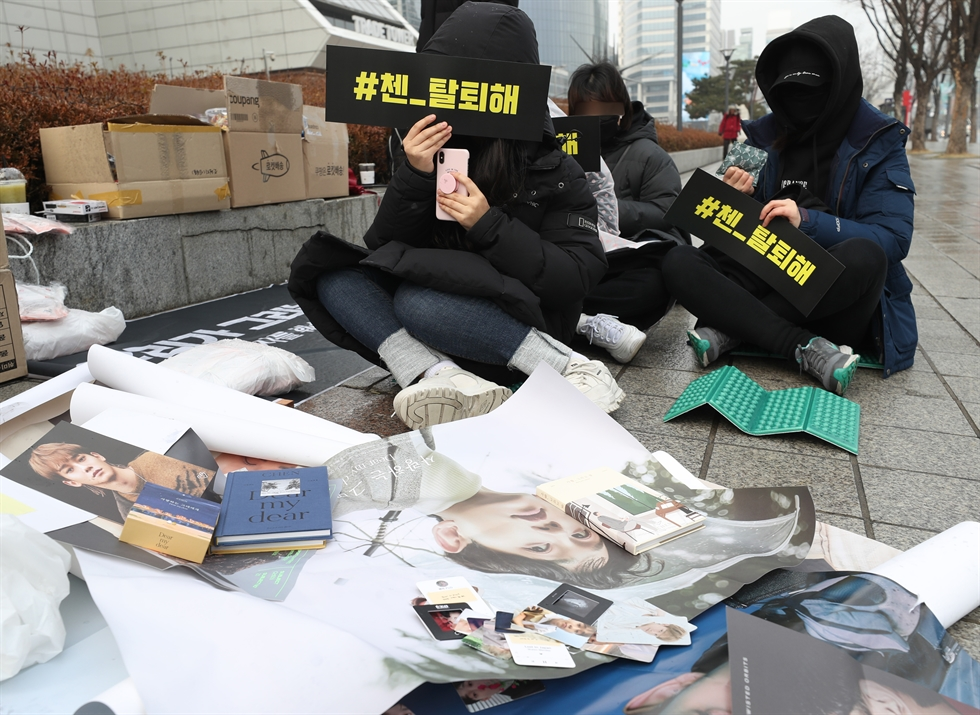Fans of disbanded boy band X1 take to the streets Wednesday in Seoul. Yonhap