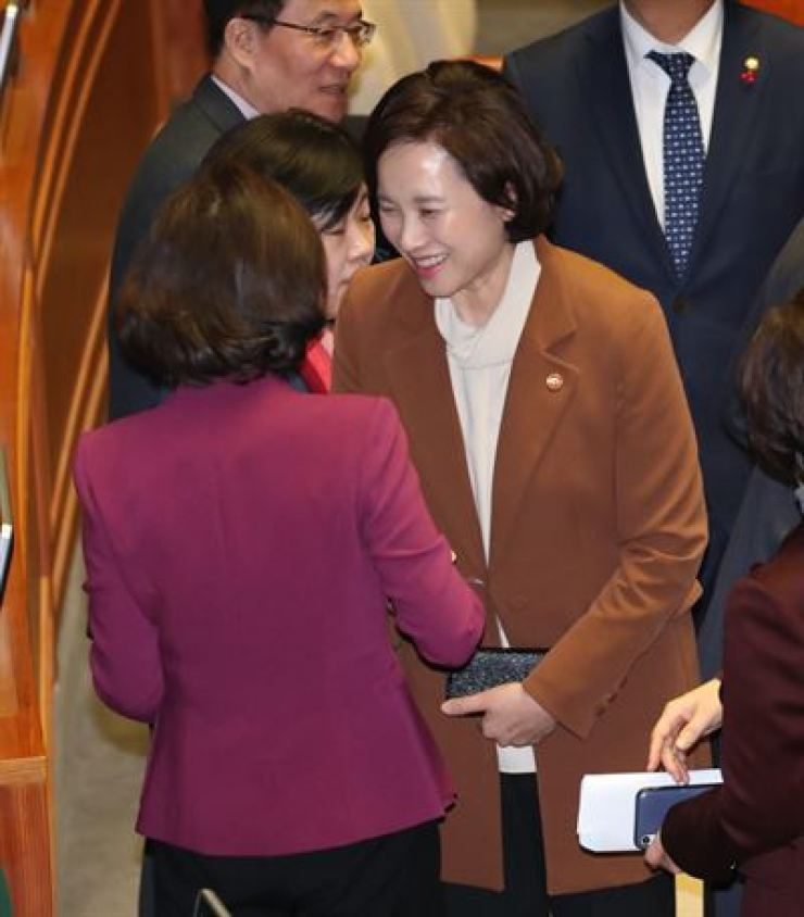 Education Minister Yoo Eun-hae, right, greets after three revision bills to improve management and accounting transparency of private kindergartens at the National Assembly plenary session in Yeouido, Seoul, Monday. /Yonhap