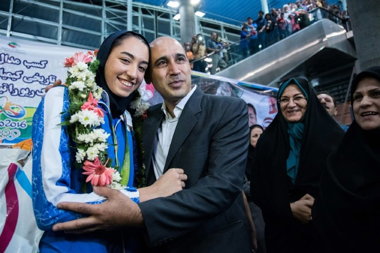 In this file photo taken on Aug. 26, 2016, Kimia Alizadeh who became the first Iranian woman ever to win an Olympic medal, is greeted by her father Keivan Alizadeh (R) upon her arrival at Imam Khomeini International Airport in Tehran. AFP