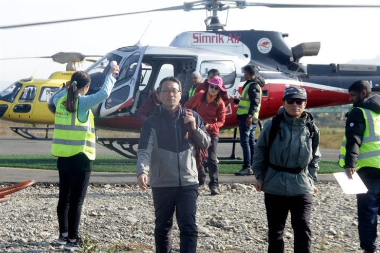 Tourists arrive after a rescue operation from Mount Annapurna base camp, at the airport of Pokhara, some 200 km west of Kathmandu, on January 18, 2020. Four South Koreans and three Nepalis are missing and about 200 people have been rescued after an avalanche hit trekkers on Annapurna, one of the highest mountains in the Himalayas, officials said on January 18. (Photo by KRISHNA MANI BARAL / AFP)