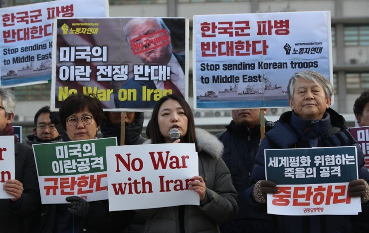 Progressive activists stage a rally in Seoul, Thursday, against latest U.S. attack on Iran and Korea's possible joining of a U.S.-led naval mission in the Strait of Hormuz near Iran. Yonhap