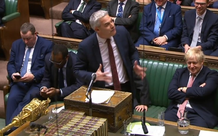 A video grab from footage broadcast by the UK Parliament's Parliamentary Recording Unit (PRU) shows Britain's Prime Minister Boris Johnson (R) reacting as Britain's Secretary of State for Exiting the European Union (Brexit Minister) Stephen Barclay speaking during the conclusion of proceedings of the European Union (Withdrawal Agreement) Bill, in the House of Commons in London on January 9, 2020. AFP