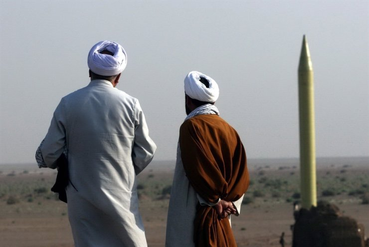 Iranian clerics look at a ballistic missile Shahab 1 during the second day of military exercises, codenamed Great Prophet-6, by Iran's elite Revolutionary Guards at an undisclosed location in Iran, June 28, 2011. According to Iranian state TV on Jan. 7, 2020, Iran's Revolutionary Guard Crops (IRGC) launched a series of rockets targeting Ain al-Assad air base located in al-Anbar, one of the bases hosting U.S. military troops in Iraq. The attack comes days after the Top Irani General Qassem Soleimani, head of the IRGC's Quds force, was killed by a U.S. drone strike in Baghdad. EPA