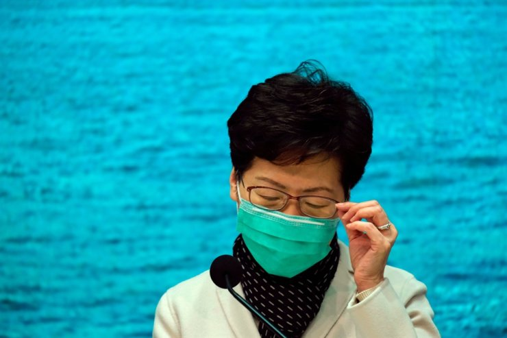 Hong Kong Chief Executive Carrie Lam wears a mask, following the outbreak of a new coronavirus, during a news conference, in Hong Kong, China January 28, 2020. REUTERS/Tyrone Siu