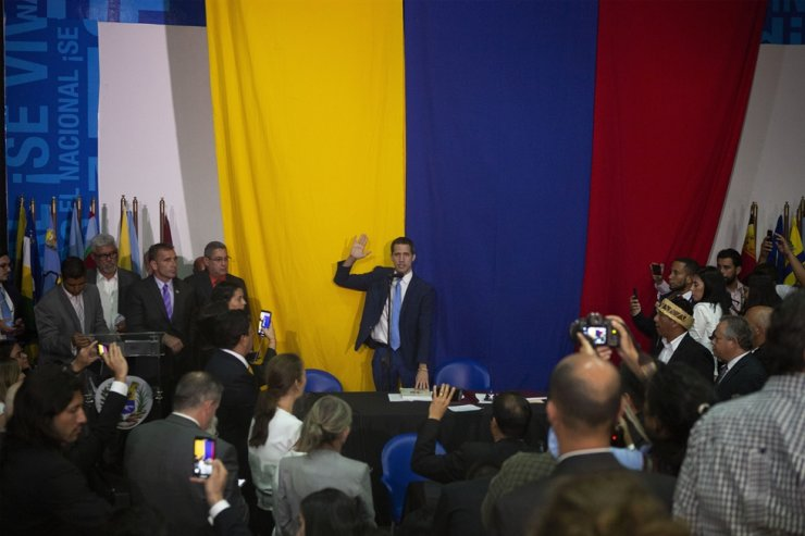 National Assembly President Juan Guaido swears himself in as President of the National Assembly with opposition lawmaker votes at the newspaper El Nacional's headquarters in Caracas, Venezuela, Sunday, Jan. 5, 2020. AP