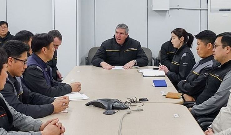 Renault Group Executive Vice President for Manufacturing and Supply Chain Jose Vicente de los Mozos, center, speaks to Renault Samsung employees during his visit to the company's Busan plant in this February 2019 photo. Courtesy of Renault Samsung
