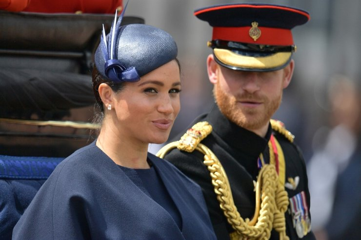 In this file photo taken on June 08, 2019, Britain's Meghan, Duchess of Sussex (L) and Britain's Prince Harry, Duke of Sussex (R) return to Buckingham Palace after the Queen's Birthday Parade, 'Trooping the Colour', in London. Britain's Queen Elizabeth II on Jan. 13, 2020, said Prince Harry and his wife Meghan would be allowed to split their time between Britain and Canada while their future is finalised. AFP