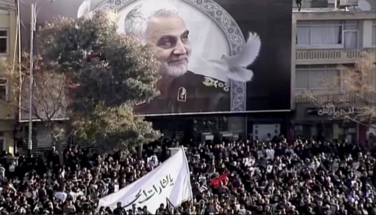 In this image made from a video, mourners gather to pay their respects to the slain Gen. Qassem Soleimani who was killed in a U.S. airstrike, in Kerman, Iran Tuesday, Jan. 7, 2020. AP