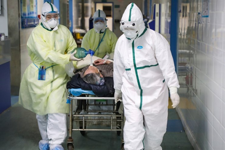 Medical staff move a 2019-nCoV patient into the isolation ward in a hospital in Wuhan, Hubei Province, China, Feb. 6. The nation is pulling medical resources from around the country to help the province, badly hit by the novel coronavirus outbreak. EPA