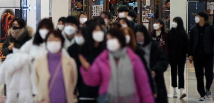 Citizens wearing facial masks walk around the Starfield COEX Mall in Seoul, Monday. / Yonhap