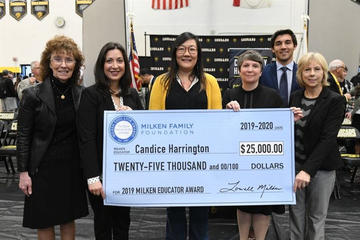 Candice Harrington, third from left, a Korean-American math teacher at Capistrano Valley High School in Viejo, Calif., holds a prize money board after winning the Milken Educator Award early this month. The annual award is given to the finest elementary and secondary school teachers in the United States and is dubbed as 'Oscars of Teaching.' Captured from Milken Family Foundation website