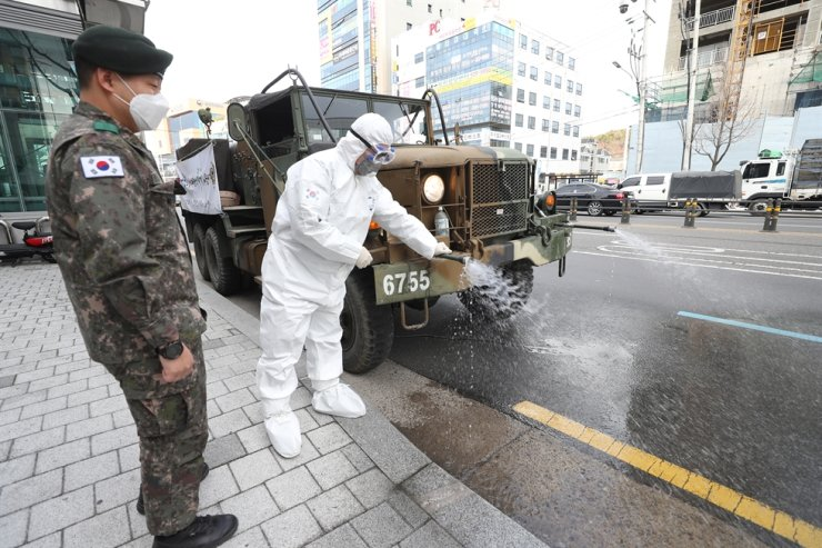 A ROK Army 50th Infantry Division truck fumigates roads in Daemyeong-dong area in Daegu's Nam-gu District, Feb. 27, to fend off further spread of the viral coronavirus. Yonhap