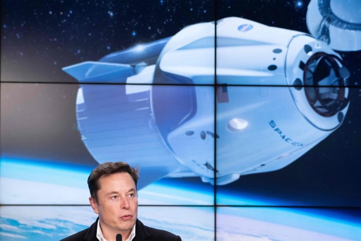 In this file photo taken on March 2, 2019 SpaceX chief Elon Musk speaks during a press conference after the launch of SpaceX Crew Dragon Demo mission at the Kennedy Space Center in Florida. - SpaceX announced a new partnership on February 18, 2020 to send four tourists deeper into orbit than any private citizen in history has gone, without disclosing the date or price tag. /AFP