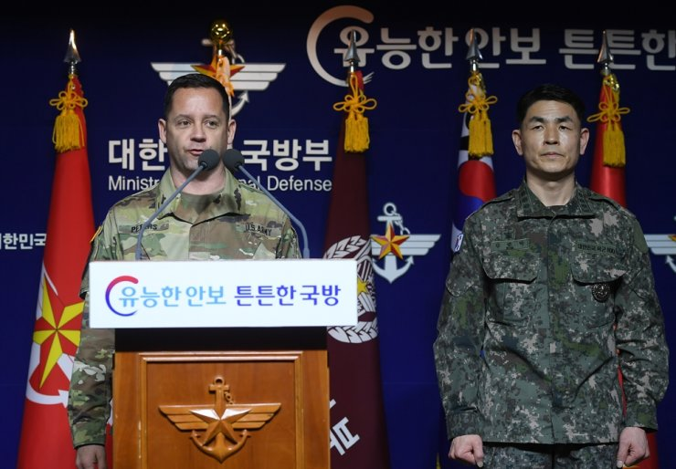 ROK-US Combined Forces Command public affairs officer COL. Peters, left, announces about the postponement of joint military exercises due to concerns over the spread of coronavirus at the Ministry of National Defense in Seoul's Yongsan District, Feb. 27. Yonhap