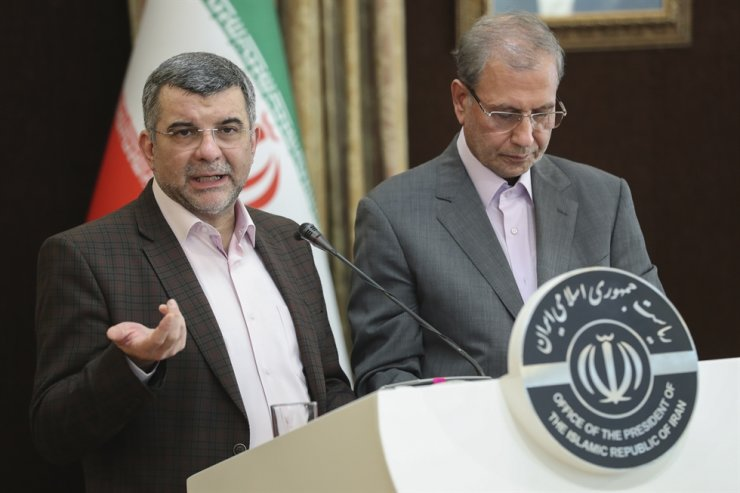 In this Monday Feb. 24, 2020 photo, released by the official website of the office of the Iranian Presidency, the head of Iran's counter-coronavirus task force, Iraj Harirchi, left, speaks at a press briefing with government spokesman Ali Rabiei, in Tehran, Iran. Harirchi, has tested positive for the virus himself, authorities announced Tuesday, amid concerns the outbreak may be far wider than officially acknowledged. The announcement regarding Harirchi came after the news conference seeking to minimize the danger posed by the outbreak. /AP