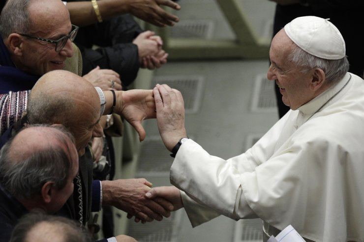 Pope Francis is greeted by faithful during the weekly general audience at the Vatican, Wednesday, Feb. 12, 2020. AP