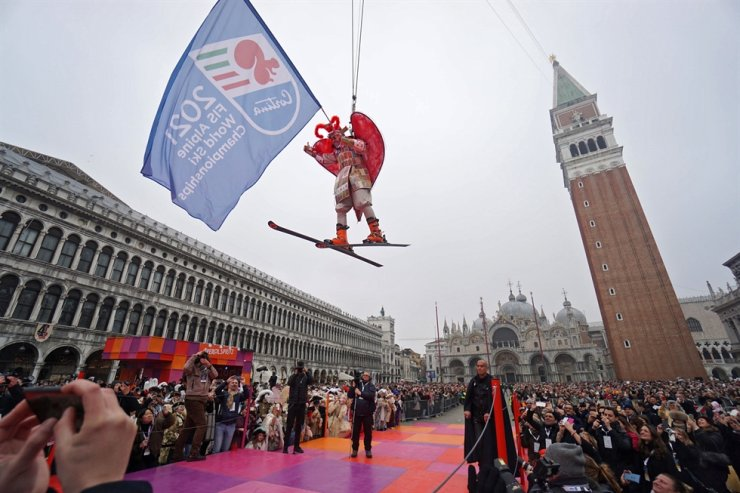 The Italian alpine skiing champion Kristian Ghedina, descends on a zip line from the Campanile (bell tower) into the piazza San Marco (St. Mark's Square) during the tradizional Volo dell' Aquila (Flight of the Eagle), event that marks the official closing of the celebrations of Venice Carnival at St. Mark's Square in Venice, Italy, Sunday. EPA